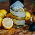 Cocktail with lemons and cucumber.